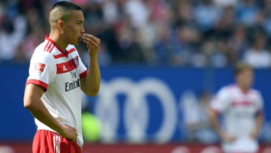 Hamburg's US forward Bobby Wood reacts during the German first division Bundesliga football match Hamburger SV vs Borussia Moenchengladbach in Hamburg, northern Germany, on May 12, 2018. (Photo by Daniel Reinhardt / dpa / AFP) / RESTRICTIONS: DURING MATCH TIME: DFL RULES TO LIMIT THE ONLINE USAGE TO 15 PICTURES PER MATCH AND FORBID IMAGE SEQUENCES TO SIMULATE VIDEO. == RESTRICTED TO EDITORIAL USE == FOR FURTHER QUERIES PLEASE CONTACT DFL DIRECTLY AT + 49 69 650050        (Photo credit should read DANIEL REINHARDT/AFP/Getty Images)