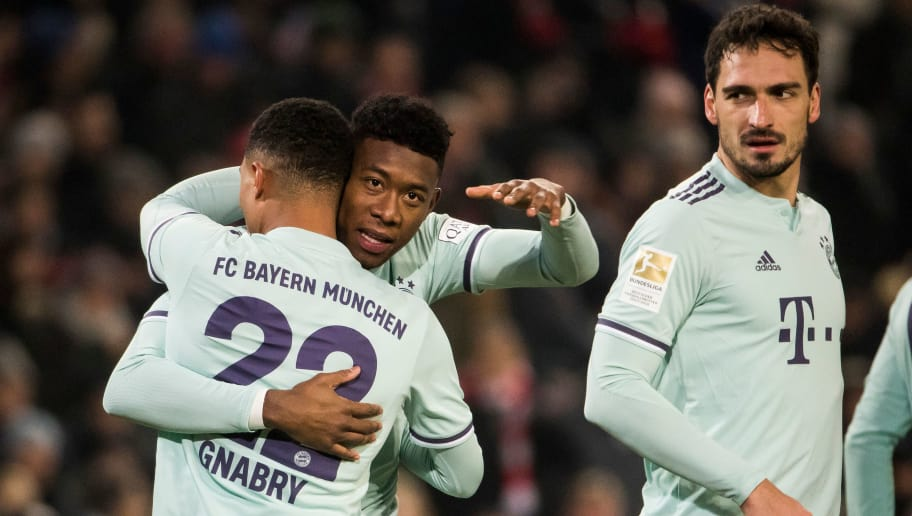 Bayern Munich's German midfielder Serge Gnabry (L) celebrates scoring with team mates Bayern Munich's Austrian defender David Alaba (C) and Bayern Munich's German defender Mats Hummels during the German first division Bundesliga football match Hannover 96 v Bayern Munich at the HDI arena in Hanover, central Germany on December 15, 2018. (Photo by Odd ANDERSEN / AFP) / DFL REGULATIONS PROHIBIT ANY USE OF PHOTOGRAPHS AS IMAGE SEQUENCES AND/OR QUASI-VIDEO        (Photo credit should read ODD ANDERSEN/AFP/Getty Images)
