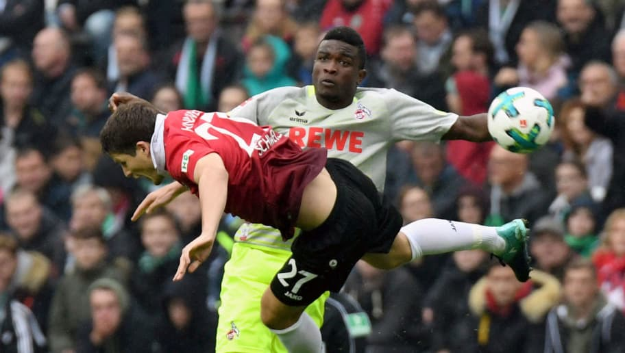 Hanover's German midfielder Pirmin Schwegler (front) and Cologne's Colombian forward Jhon Cordoba vie for the ball during the German first division Bundesliga football match Hanover 96 vs 1 FC Cologne in Hanover, central Germany on September 24, 2017. / AFP PHOTO / dpa / Peter STEFFEN / NO Getty Images (GETTY-VD) - Germany OUT / RESTRICTIONS: DURING MATCH TIME: DFL RULES TO LIMIT THE ONLINE USAGE TO 15 PICTURES PER MATCH AND FORBID IMAGE SEQUENCES TO SIMULATE VIDEO. == RESTRICTED TO EDITORIAL USE == FOR FURTHER QUERIES PLEASE CONTACT DFL DIRECTLY AT + 49 69 650050  /         (Photo credit should read PETER STEFFEN/AFP/Getty Images)