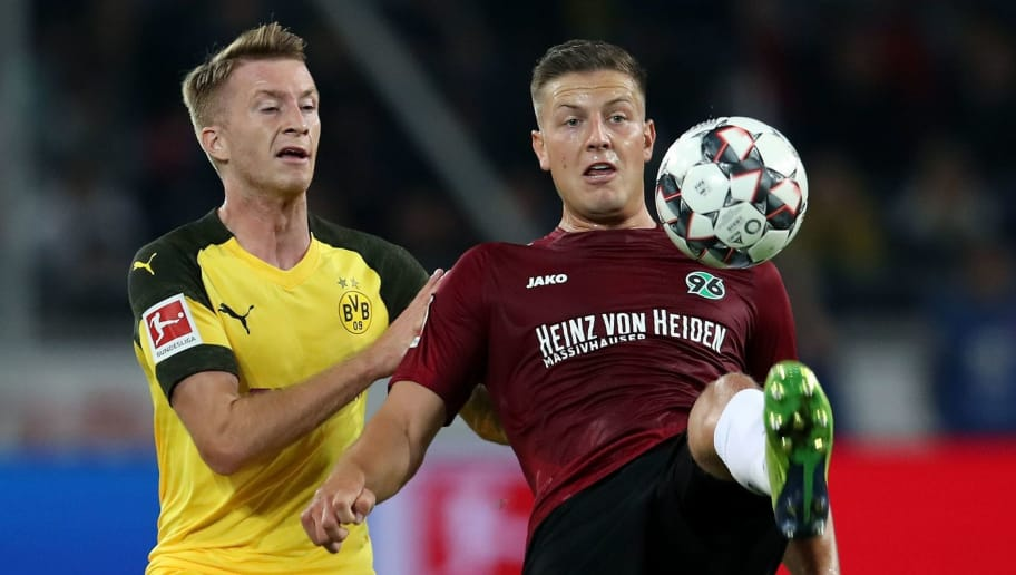 Dortmund's German forward Marco Reus (L) vies with Hanover's Austrian defender Kevin Wimmer (R) during the German first division Bundesliga football match Hannover 96 vs Borussia Dortmund in Hanover, northern Germany, on August 31, 2018. (Photo by Ronny Hartmann / AFP) / RESTRICTIONS: DFL REGULATIONS PROHIBIT ANY USE OF PHOTOGRAPHS AS IMAGE SEQUENCES AND/OR QUASI-VIDEO        (Photo credit should read RONNY HARTMANN/AFP/Getty Images)
