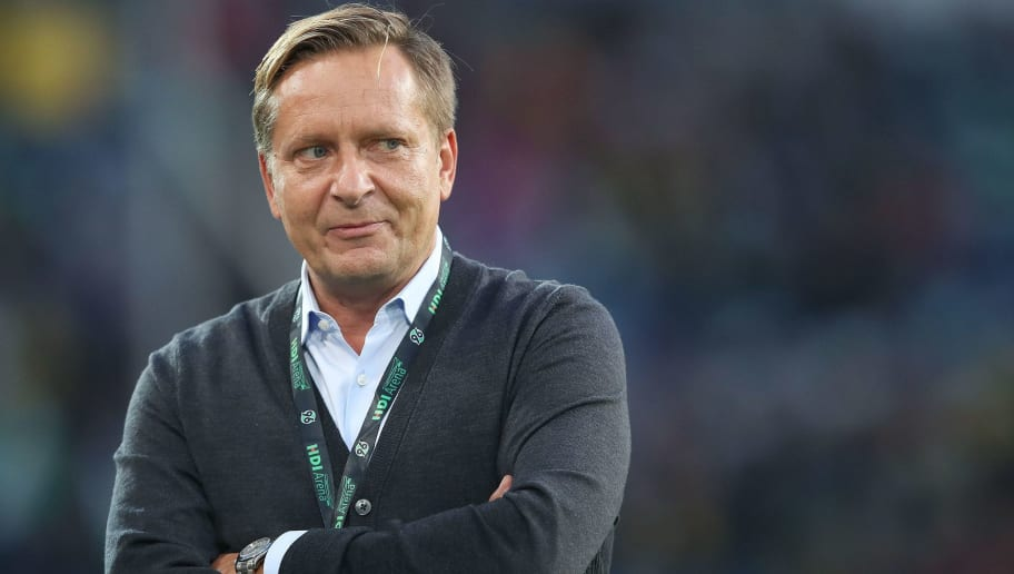 Hanover's manager Horst Heldt is pictured prior to the German first division Bundesliga football match Hannover 96 vs Borussia Dortmund in Hanover, northern Germany, on August 31, 2018. (Photo by Ronny Hartmann / AFP) / RESTRICTIONS: DFL REGULATIONS PROHIBIT ANY USE OF PHOTOGRAPHS AS IMAGE SEQUENCES AND/OR QUASI-VIDEO        (Photo credit should read RONNY HARTMANN/AFP/Getty Images)