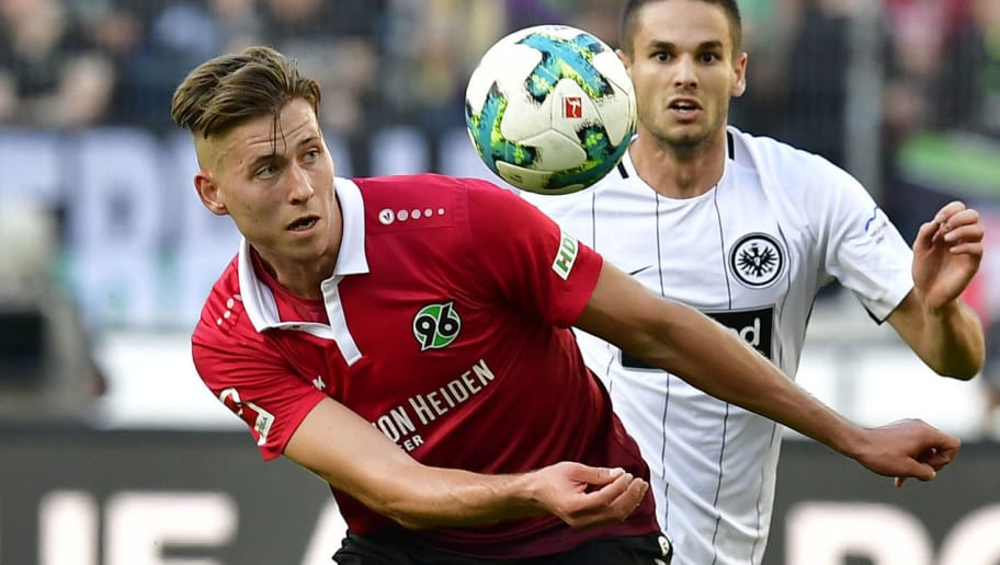 Hanover's German defender Waldemar Anton (L) and Frankfurt's Serbian midfielder Mijat Gacinovic vie for the ball during the German First division Bundesliga football match Hannover 96 vs Eintracht Frankfurt in Hanover, central Germany, on October 14, 2017. / AFP PHOTO / Tobias SCHWARZ / RESTRICTIONS: DURING MATCH TIME: DFL RULES TO LIMIT THE ONLINE USAGE TO 15 PICTURES PER MATCH AND FORBID IMAGE SEQUENCES TO SIMULATE VIDEO. == RESTRICTED TO EDITORIAL USE == FOR FURTHER QUERIES PLEASE CONTACT DFL DIRECTLY AT + 49 69 650050         (Photo credit should read TOBIAS SCHWARZ/AFP/Getty Images)