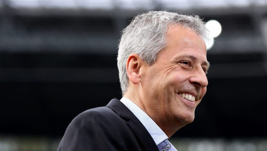 Moenchengladbach's Swiss head coach Lucien Favre smiles prior to the German First division Bundesliga football match Hannover 96 vs Borussia Moenchengladbach on October 18, 2014 in Hanover, northern Germany. AFP PHOTO / RONNY HARTMANN  DFL RULES TO LIMIT THE ONLINE USAGE DURING MATCH TIME TO 15 PICTURES PER MATCH. IMAGE SEQUENCES TO SIMULATE VIDEO IS NOT ALLOWED AT ANY TIME. FOR FURTHER QUERIES PLEASE CONTACT DFL DIRECTLY AT + 49 69 650050.        (Photo credit should read RONNY HARTMANN/AFP/Getty Images)
