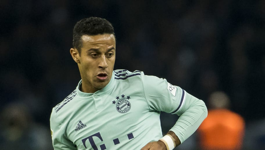Bayern Munich's Spanish midfielder Thiago Alcantara plays a pass during the German first division Bundesliga football match Hertha Berlin v Bayern Munich at the Olympic stadium in Berlin on September 28, 2018. (Photo by Odd ANDERSEN / AFP) / DFL REGULATIONS PROHIBIT ANY USE OF PHOTOGRAPHS AS IMAGE SEQUENCES AND/OR QUASI-VIDEO        (Photo credit should read ODD ANDERSEN/AFP/Getty Images)