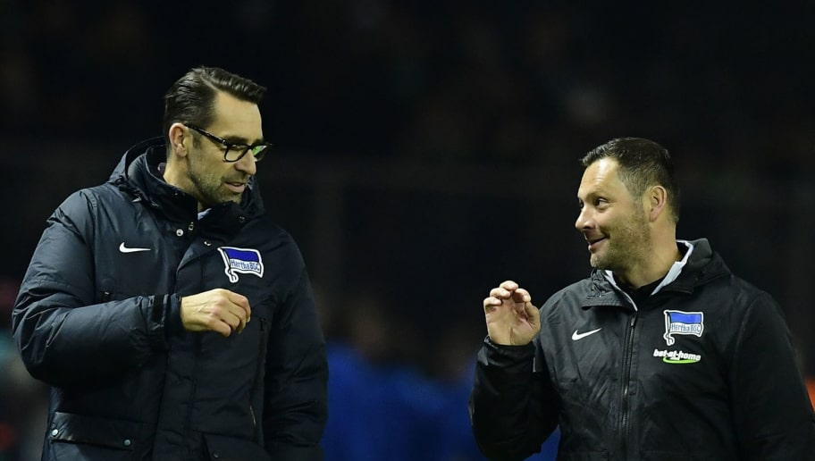 Hertha Berlin's Hungarian head coach Pal Dardai (R) chats with Hertha Berlin's sporting director Michael Preetz after the German first division Bundesliga football match between Hertha BSC Berlin and Borussia Moenchengladbach in Berlin on November 4, 2016. / AFP / TOBIAS SCHWARZ / RESTRICTIONS: DURING MATCH TIME: DFL RULES TO LIMIT THE ONLINE USAGE TO 15 PICTURES PER MATCH AND FORBID IMAGE SEQUENCES TO SIMULATE VIDEO. == RESTRICTED TO EDITORIAL USE == FOR FURTHER QUERIES PLEASE CONTACT DFL DIRECTLY AT + 49 69 650050         (Photo credit should read TOBIAS SCHWARZ/AFP/Getty Images)