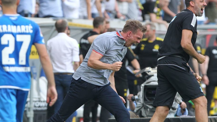 Hoffenheim's coach Julian Nagelsmann reacts at the end of the German first division Bundesliga football match TSG 1899 Hoffenheim vs Borussia Dortmund in Sinsheim, southern Germany, on May 12, 2018. - Hoffenheim won 3-1. (Photo by Amelie QUERFURTH / AFP) / RESTRICTIONS: DURING MATCH TIME: DFL RULES TO LIMIT THE ONLINE USAGE TO 15 PICTURES PER MATCH AND FORBID IMAGE SEQUENCES TO SIMULATE VIDEO. == RESTRICTED TO EDITORIAL USE == FOR FURTHER QUERIES PLEASE CONTACT DFL DIRECTLY AT + 49 69 650050        (Photo credit should read AMELIE QUERFURTH/AFP/Getty Images)