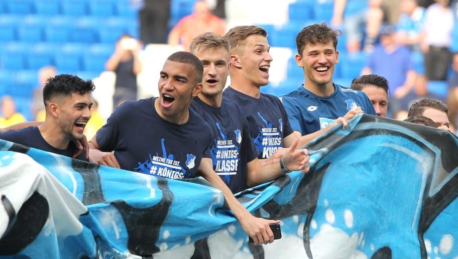Hoffenheim's players celebrate after the German first division Bundesliga football match TSG 1899 Hoffenheim vs Borussia Dortmund in Sinsheim, southern Germany, on May 12, 2018. (Photo by Amelie QUERFURTH / AFP) / RESTRICTIONS: DURING MATCH TIME: DFL RULES TO LIMIT THE ONLINE USAGE TO 15 PICTURES PER MATCH AND FORBID IMAGE SEQUENCES TO SIMULATE VIDEO. == RESTRICTED TO EDITORIAL USE == FOR FURTHER QUERIES PLEASE CONTACT DFL DIRECTLY AT + 49 69 650050        (Photo credit should read AMELIE QUERFURTH/AFP/Getty Images)