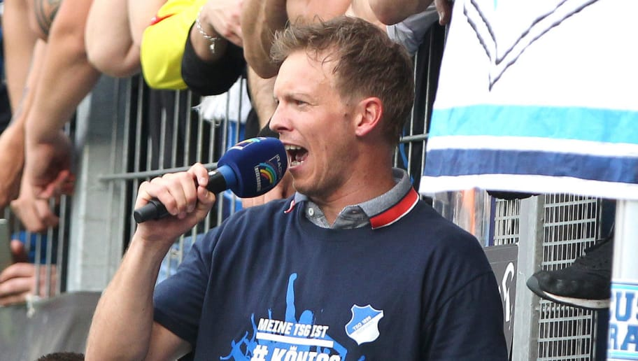 Hoffenheim's German head coach Julian Nagelsmann reacts after the German first division Bundesliga football match TSG 1899 Hoffenheim vs Borussia Dortmund in Sinsheim, southern Germany, on May 12, 2018. (Photo by Amelie QUERFURTH / AFP) / RESTRICTIONS: DURING MATCH TIME: DFL RULES TO LIMIT THE ONLINE USAGE TO 15 PICTURES PER MATCH AND FORBID IMAGE SEQUENCES TO SIMULATE VIDEO. == RESTRICTED TO EDITORIAL USE == FOR FURTHER QUERIES PLEASE CONTACT DFL DIRECTLY AT + 49 69 650050        (Photo credit should read AMELIE QUERFURTH/AFP/Getty Images)