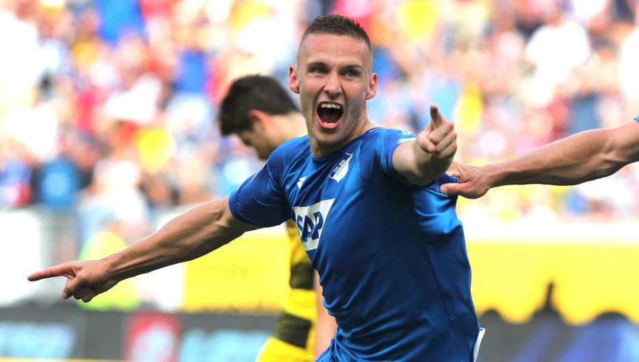 Hoffenheim's Czech defender Pavel Kaderabek celebrates after scoring the 3-1 during the German first division Bundesliga football match TSG 1899 Hoffenheim vs Borussia Dortmund in Sinsheim, southern Germany, on May 12, 2018. (Photo by Amelie QUERFURTH / AFP) / RESTRICTIONS: DURING MATCH TIME: DFL RULES TO LIMIT THE ONLINE USAGE TO 15 PICTURES PER MATCH AND FORBID IMAGE SEQUENCES TO SIMULATE VIDEO. == RESTRICTED TO EDITORIAL USE == FOR FURTHER QUERIES PLEASE CONTACT DFL DIRECTLY AT + 49 69 650050        (Photo credit should read AMELIE QUERFURTH/AFP/Getty Images)