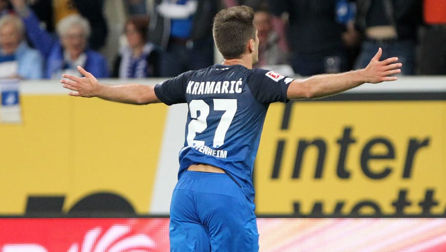 Hoffenheim's Croatian forward Andrej Kramaric celebrates scoring the 3-1 during the German First division Bundesliga football match TSG 1899 Hoffenheim vs Hanover 96 in Sinsheim, southern Germany on April 27, 2018. (Photo by Daniel ROLAND / AFP) / RESTRICTIONS: DURING MATCH TIME: DFL RULES TO LIMIT THE ONLINE USAGE TO 15 PICTURES PER MATCH AND FORBID IMAGE SEQUENCES TO SIMULATE VIDEO. == RESTRICTED TO EDITORIAL USE == FOR FURTHER QUERIES PLEASE CONTACT DFL DIRECTLY AT + 49 69 650050 / RESTRICTIONS: DURING MATCH TIME: DFL RULES TO LIMIT THE ONLINE USAGE TO 15 PICTURES PER MATCH AND FORBID IMAGE SEQUENCES TO SIMULATE VIDEO. == RESTRICTED TO EDITORIAL USE == FOR FURTHER QUERIES PLEASE CONTACT DFL DIRECTLY AT + 49 69 650050        (Photo credit should read DANIEL ROLAND/AFP/Getty Images)