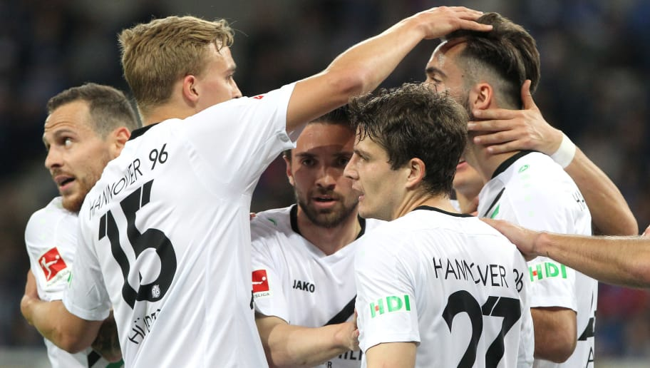 Hanover's players celebrates scoring the 1-1 goal the German First division Bundesliga football match TSG 1899 Hoffenheim vs Hanover 96 in Sinsheim, southern Germany on April 27, 2018. (Photo by Daniel ROLAND / AFP) / RESTRICTIONS: DURING MATCH TIME: DFL RULES TO LIMIT THE ONLINE USAGE TO 15 PICTURES PER MATCH AND FORBID IMAGE SEQUENCES TO SIMULATE VIDEO. == RESTRICTED TO EDITORIAL USE == FOR FURTHER QUERIES PLEASE CONTACT DFL DIRECTLY AT + 49 69 650050 / RESTRICTIONS: DURING MATCH TIME: DFL RULES TO LIMIT THE ONLINE USAGE TO 15 PICTURES PER MATCH AND FORBID IMAGE SEQUENCES TO SIMULATE VIDEO. == RESTRICTED TO EDITORIAL USE == FOR FURTHER QUERIES PLEASE CONTACT DFL DIRECTLY AT + 49 69 650050        (Photo credit should read DANIEL ROLAND/AFP/Getty Images)