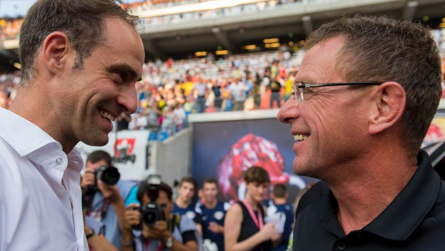 The head of RB Leipzig Oliver Mintzlaff (L) and Manager Ralf Rangnick chats prior to the German first division Bundesliga football match between RB Leipzig and BVB Borrusia Dortmund in Leipzig, eastern Germany on September 10, 2016.  / AFP / ROBERT MICHAEL        (Photo credit should read ROBERT MICHAEL/AFP/Getty Images)
