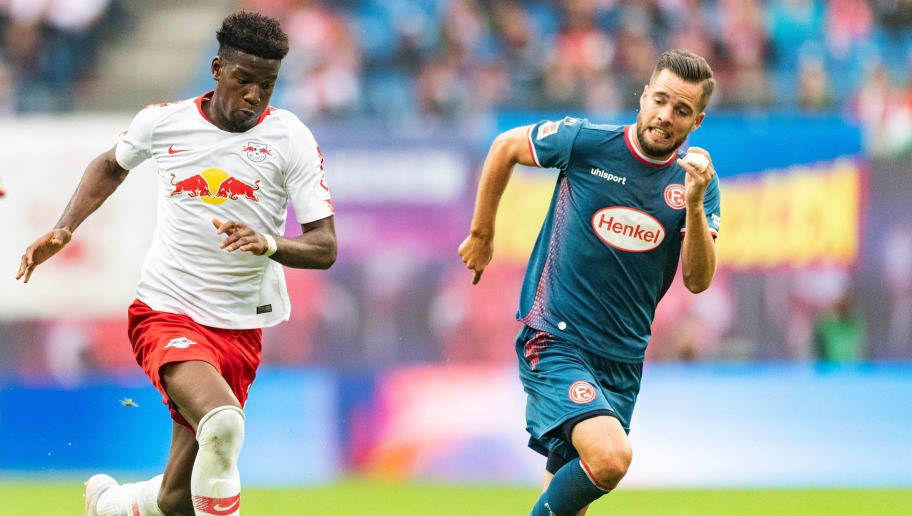 Leipzig's French defender Nordi Mukiele (L) and Fortuna Duesseldorf's German defender Niko Giesselmann vie for the ball during the German first division Bundesliga football match RB Leipzig vs Fortuna Duesseldorf in Leipzig, eastern Germany, on September 2, 2018. (Photo by ROBERT MICHAEL / AFP) / RESTRICTIONS: DFL REGULATIONS PROHIBIT ANY USE OF PHOTOGRAPHS AS IMAGE SEQUENCES AND/OR QUASI-VIDEO        (Photo credit should read ROBERT MICHAEL/AFP/Getty Images)