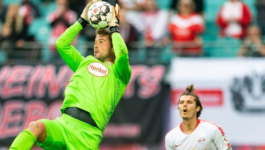 Duesseldorf´s goalkeeper Michael Rensing (L) safes a ball next to Leipzig´s Austrian forward Marcel Sabitzer during the German first division Bundesliga football match RB Leipzig vs Fortuna Duesseldorf in Leipzig, eastern Germany, on September 2, 2018. (Photo by ROBERT MICHAEL / AFP) / RESTRICTIONS: DFL REGULATIONS PROHIBIT ANY USE OF PHOTOGRAPHS AS IMAGE SEQUENCES AND/OR QUASI-VIDEO        (Photo credit should read ROBERT MICHAEL/AFP/Getty Images)