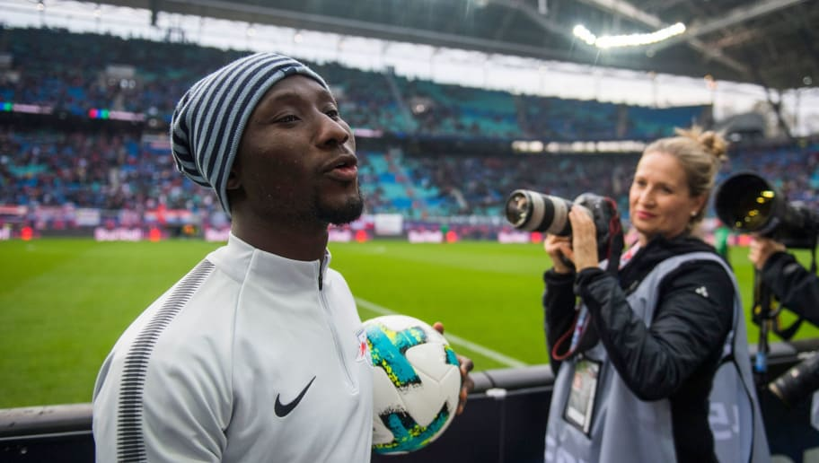 Leipzig´s Guinean midfielder Naby Deco Keita leaves the field after the warm up prior to the German first division Bundesliga football match between RB Leipzig and Hannover 96 in Leipzig, eastern Germany on November 3, 2017.  / AFP PHOTO / ROBERT MICHAEL / RESTRICTIONS: DURING MATCH TIME: DFL RULES TO LIMIT THE ONLINE USAGE TO 15 PICTURES PER MATCH AND FORBID IMAGE SEQUENCES TO SIMULATE VIDEO. == RESTRICTED TO EDITORIAL USE == FOR FURTHER QUERIES PLEASE CONTACT DFL DIRECTLY AT + 49 69 650050         (Photo credit should read ROBERT MICHAEL/AFP/Getty Images)