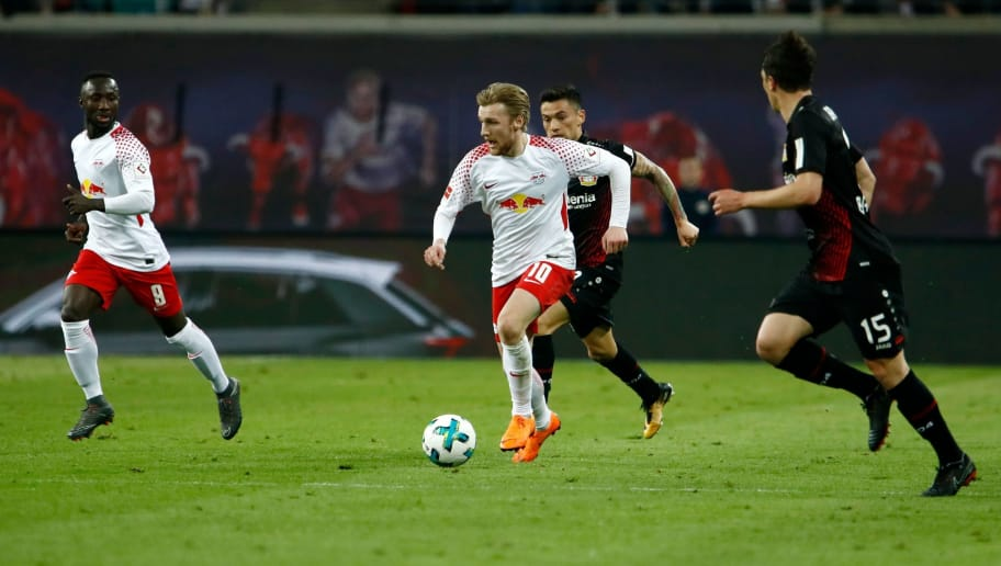 Leipzig's Swedish midfielder Emil Forsberg (C) runs with the ball next to Leipzig's Guinean midfielder Naby Keita (L) and Leverkusen's Austrian midflielder Julian Baumgartlinger during the German first division Bundesliga football match between Bayer Leverkusen vs RB Leipzig in Leipzig, eastern Germany, on April 9, 2018. / AFP PHOTO / Odd ANDERSEN / RESTRICTIONS: DURING MATCH TIME: DFL RULES TO LIMIT THE ONLINE USAGE TO 15 PICTURES PER MATCH AND FORBID IMAGE SEQUENCES TO SIMULATE VIDEO. == RESTRICTED TO EDITORIAL USE == FOR FURTHER QUERIES PLEASE CONTACT DFL DIRECTLY AT + 49 69 650050         (Photo credit should read ODD ANDERSEN/AFP/Getty Images)