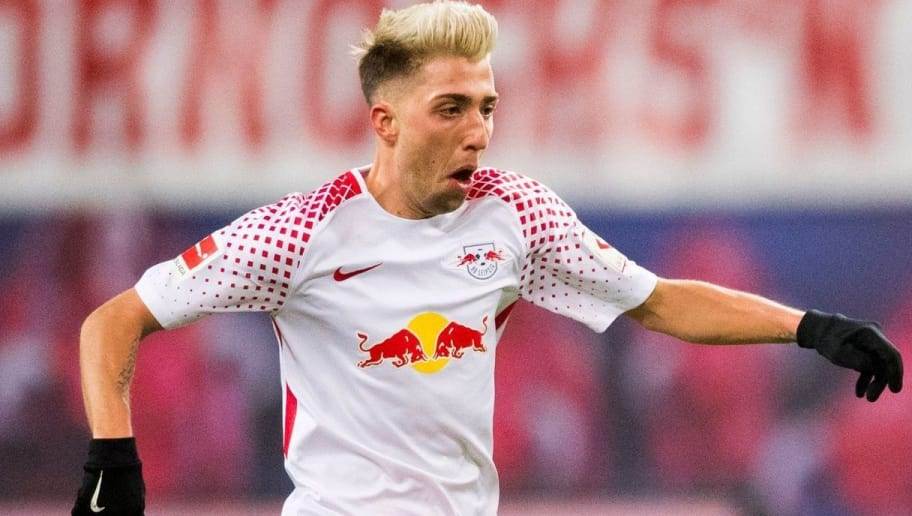Leipzig's Slovanian midfielder Kevin Kampl plays the ball during the German first division Bundesliga football match between RB Leipzig and FC Bayern Munich in Leipzig, eastern Germany on March 18, 2018.  / AFP PHOTO / ROBERT MICHAEL        (Photo credit should read ROBERT MICHAEL/AFP/Getty Images)