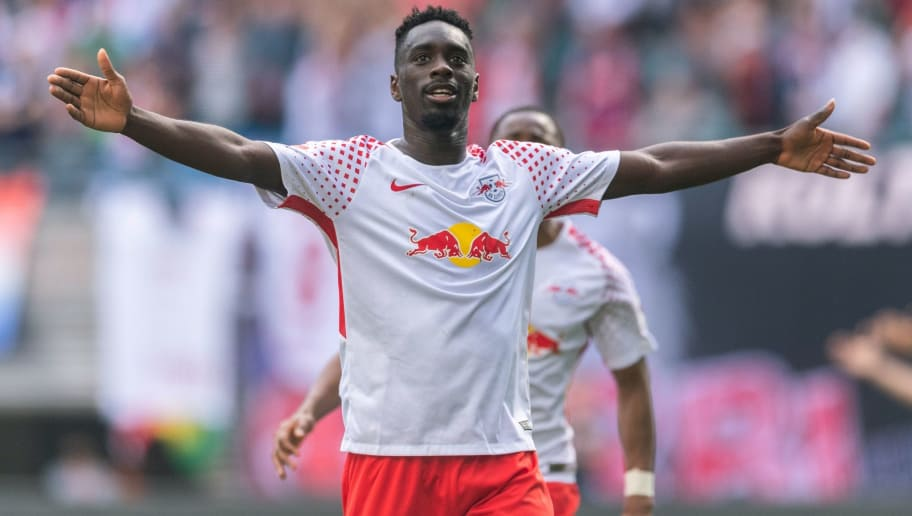 Leipzig's French forward Jean-Kevin Augustin celebrates after scoring the 4-1 during the German first division Bundesliga football match RB Leipzig vs VfL Wolfsburg in Leipzig, eastern Germany, on May 5, 2018. (Photo by ROBERT MICHAEL / AFP) / RESTRICTIONS: DURING MATCH TIME: DFL RULES TO LIMIT THE ONLINE USAGE TO 15 PICTURES PER MATCH AND FORBID IMAGE SEQUENCES TO SIMULATE VIDEO. == RESTRICTED TO EDITORIAL USE == FOR FURTHER QUERIES PLEASE CONTACT DFL DIRECTLY AT + 49 69 650050        (Photo credit should read ROBERT MICHAEL/AFP/Getty Images)