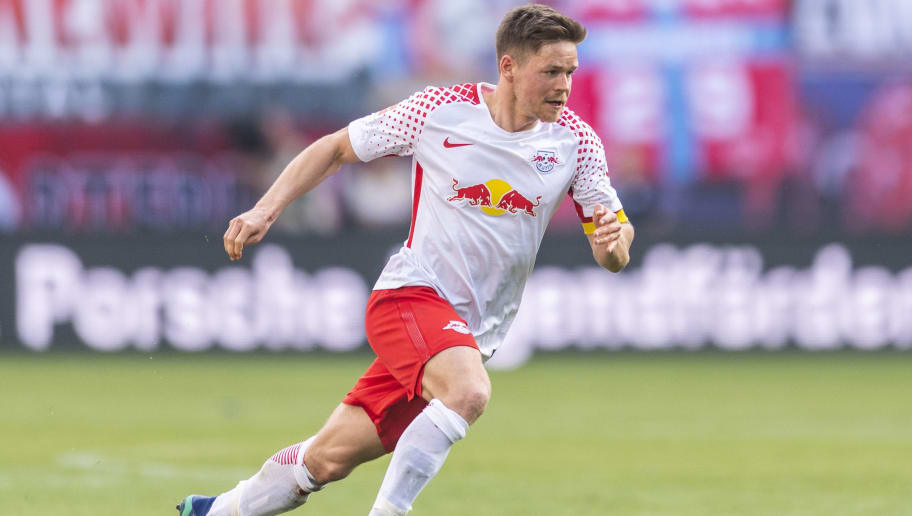Leipzig´s midfielder Dominik Kaiser plays the ball during the German first division Bundesliga football match between RB Leipzig and VfL Wolfsburg in Leipzig, eastern Germany on May 5, 2018. (Photo by ROBERT MICHAEL / AFP) / RESTRICTIONS: DURING MATCH TIME: DFL RULES TO LIMIT THE ONLINE USAGE TO 15 PICTURES PER MATCH AND FORBID IMAGE SEQUENCES TO SIMULATE VIDEO. == RESTRICTED TO EDITORIAL USE == FOR FURTHER QUERIES PLEASE CONTACT DFL DIRECTLY AT + 49 69 650050        (Photo credit should read ROBERT MICHAEL/AFP/Getty Images)
