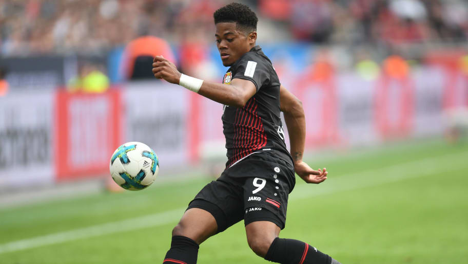 Leverkusen's Jamaican midfielder Leon Bailey controls the ball during the German first division Bundesliga football match Bayer 04 Leverkusen vs Eintracht Frankfurt, in Leverkusen, western Germany, on April 14, 2018. / AFP PHOTO / Patrik STOLLARZ / RESTRICTIONS: DURING MATCH TIME: DFL RULES TO LIMIT THE ONLINE USAGE TO 15 PICTURES PER MATCH AND FORBID IMAGE SEQUENCES TO SIMULATE VIDEO. == RESTRICTED TO EDITORIAL USE == FOR FURTHER QUERIES PLEASE CONTACT DFL DIRECTLY AT + 49 69 650050         (Photo credit should read PATRIK STOLLARZ/AFP/Getty Images)