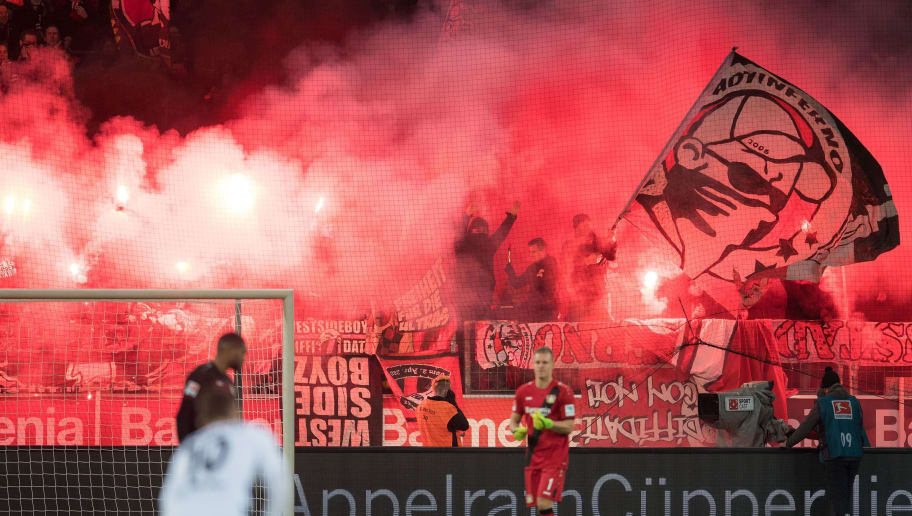 This picture taken on January 28, 2017 in Leverkusen, western Germany, shows Leverkusen fans using pyrotechnics during the German first division Bundesliga football match between Bayer 04 Leverkusen and Borussia Moenchengladbach.  Bayer Leverkusen could face a heavy fine after a German Football League (DFL) cameraman and a steward were injured by pyrotechnics ignited by home fans before a Bundesliga match. / AFP / dpa / Marius Becker / NO Getty Images (GETTY-VD) - Germany OUT / RESTRICTIONS: DURING MATCH TIME: DFL RULES TO LIMIT THE ONLINE USAGE TO 15 PICTURES PER MATCH AND FORBID IMAGE SEQUENCES TO SIMULATE VIDEO. == RESTRICTED TO EDITORIAL USE == FOR FURTHER QUERIES PLEASE CONTACT DFL DIRECTLY AT + 49 69 650050  /         (Photo credit should read MARIUS BECKER/AFP/Getty Images)