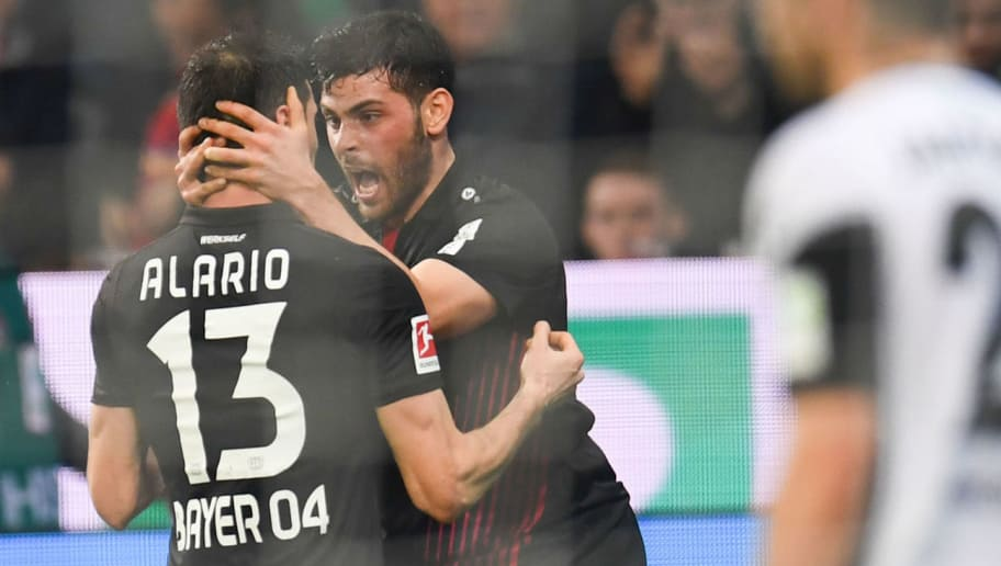 Leverkusen's Argentinean forward Lucas Alario and Leverkusen's German forward Kevin Volland celebrate scoring during the German first division Bundesliga football match Bayer 04 Leverkusen vs Borussia Moenchengladbach, in Leverkusen, western Germany, on March 10, 2018. / AFP PHOTO / Patrik STOLLARZ / RESTRICTIONS: DURING MATCH TIME: DFL RULES TO LIMIT THE ONLINE USAGE TO 15 PICTURES PER MATCH AND FORBID IMAGE SEQUENCES TO SIMULATE VIDEO. == RESTRICTED TO EDITORIAL USE == FOR FURTHER QUERIES PLEASE CONTACT DFL DIRECTLY AT + 49 69 650050         (Photo credit should read PATRIK STOLLARZ/AFP/Getty Images)