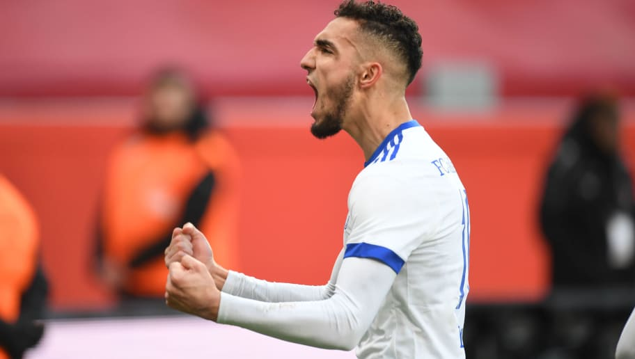 Schalke's Algerian midfielder Nabil Bentaleb celebrates during the German first division Bundesliga football match Bayer Leverkusen vs Schalke 04 in Leverkusen, western Germany, on February 25, 2018. / AFP PHOTO / Patrik STOLLARZ / RESTRICTIONS: DURING MATCH TIME: DFL RULES TO LIMIT THE ONLINE USAGE TO 15 PICTURES PER MATCH AND FORBID IMAGE SEQUENCES TO SIMULATE VIDEO. == RESTRICTED TO EDITORIAL USE == FOR FURTHER QUERIES PLEASE CONTACT DFL DIRECTLY AT + 49 69 650050         (Photo credit should read PATRIK STOLLARZ/AFP/Getty Images)