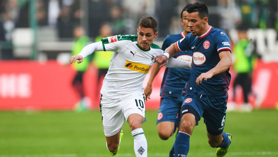 Fortuna Duesseldorf's German-US midfielder Alfredo Morales and Moenchengladbach's Belgian forward Thorgan Hazard vie for the ball during the German first division Bundesliga football match Borussia Moenchengladbach v Fortuna Dusseldorf in Moenchengladbach, western Germany on November 04, 2018. (Photo by Patrik STOLLARZ / AFP) / RESTRICTIONS: DFL REGULATIONS PROHIBIT ANY USE OF PHOTOGRAPHS AS IMAGE SEQUENCES AND/OR QUASI-VIDEO        (Photo credit should read PATRIK STOLLARZ/AFP/Getty Images)