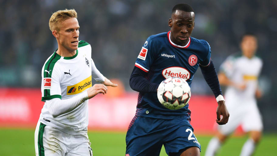 Fortuna Duesseldorf's Belgian midfielder Dodi Lukebakio (R) and Moenchengladbach's Swedish defender Oscar Wendt vie for the ball  during the German first division Bundesliga football match Borussia Moenchengladbach v Fortuna Dusseldorf in Moenchengladbach, western Germany on November 04, 2018. (Photo by Patrik STOLLARZ / AFP) / RESTRICTIONS: DFL REGULATIONS PROHIBIT ANY USE OF PHOTOGRAPHS AS IMAGE SEQUENCES AND/OR QUASI-VIDEO        (Photo credit should read PATRIK STOLLARZ/AFP/Getty Images)