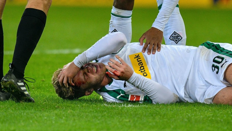 Moenchengladbach's Swiss defender Nico Elvedi lays injured during the German first division Bundesliga football match Borussia Moenchengladbach v FC Nuremberg in Moenchengladbach, western Germany on December 18, 2018. (Photo by SASCHA SCHUERMANN / AFP) / RESTRICTIONS: DFL REGULATIONS PROHIBIT ANY USE OF PHOTOGRAPHS AS IMAGE SEQUENCES AND/OR QUASI-VIDEO        (Photo credit should read SASCHA SCHUERMANN/AFP/Getty Images)