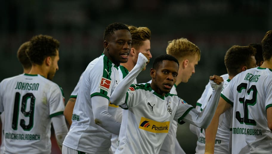 Moenchengladbach's Guinean midfielder Ibrahima Traore (C) celebrates leading 1:0 with team players during the German first division Bundesliga football match Borussia Moenchengladbach v FC Nuremberg in Moenchengladbach, western Germany on December 18, 2018. (Photo by SASCHA SCHUERMANN / AFP) / RESTRICTIONS: DFL REGULATIONS PROHIBIT ANY USE OF PHOTOGRAPHS AS IMAGE SEQUENCES AND/OR QUASI-VIDEO        (Photo credit should read SASCHA SCHUERMANN/AFP/Getty Images)