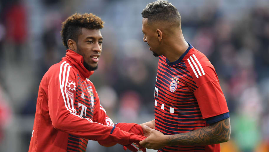 Bayern Munich's French defender Kingsley Coman and his teammate Bayern Munich's defender Jerome Boateng arrive for the warm up prior to the German First division Bundesliga football match Bayern Munich vs Hannover 96 on December 2, 2017 in Munich. / AFP PHOTO / Christof STACHE / RESTRICTIONS: DURING MATCH TIME: DFL RULES TO LIMIT THE ONLINE USAGE TO 15 PICTURES PER MATCH AND FORBID IMAGE SEQUENCES TO SIMULATE VIDEO. == RESTRICTED TO EDITORIAL USE == FOR FURTHER QUERIES PLEASE CONTACT DFL DIRECTLY AT + 49 69 650050         (Photo credit should read CHRISTOF STACHE/AFP/Getty Images)