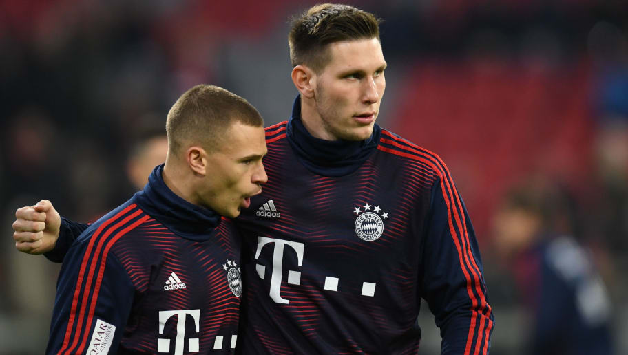 Bayern Munich's German midfielder Joshua Kimmich (L) and Bayern Munich's German defender Niklas Suele attend the warm up prior the German first division football match between 1 FC Bayern Munich and RB Leipzig in Munich, southern Germany, on December 19, 2018. (Photo by Christof STACHE / AFP) / DFL REGULATIONS PROHIBIT ANY USE OF PHOTOGRAPHS AS IMAGE SEQUENCES AND/OR QUASI-VIDEO        (Photo credit should read CHRISTOF STACHE/AFP/Getty Images)