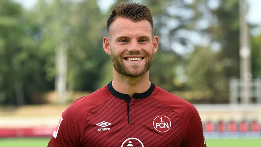 Nuremberg's midfielder Eduard Loewen poses during the presentation of the football team of the German first division Bundesliga club FC Nuremberg on July 16, 2018 in Nuremberg, southern Germany. (Photo by Christof STACHE / AFP)        (Photo credit should read CHRISTOF STACHE/AFP/Getty Images)