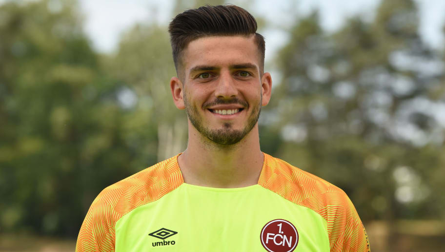 Nuremberg's goalkeeper Fabian Bredlow poses during the presentation of the football team of the German first division Bundesliga club FC Nuremberg on July 16, 2018 in Nuremberg, southern Germany. (Photo by Christof STACHE / AFP)        (Photo credit should read CHRISTOF STACHE/AFP/Getty Images)