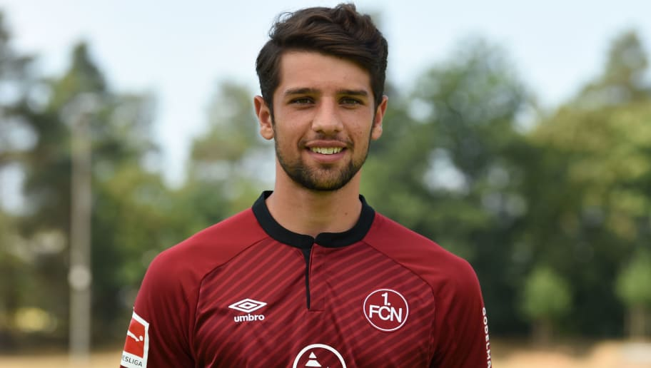 Nuremberg's defender Lukas Muehl poses during the presentation of the football team of the German first division Bundesliga club FC Nuremberg on July 16, 2018 in Nuremberg, southern Germany. (Photo by Christof STACHE / AFP)        (Photo credit should read CHRISTOF STACHE/AFP/Getty Images)