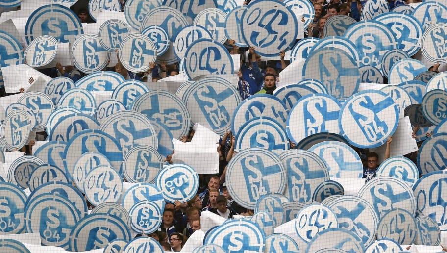 Schalke fans celebrate with the logo of the club during the German first division Bundesliga football match Schalke 04 vs Bayern Munich in Gelsenkirchen, western Germany on August 30, 2014. AFP PHOTO / PATRIK STOLLARZ        (Photo credit should read PATRIK STOLLARZ/AFP/Getty Images)