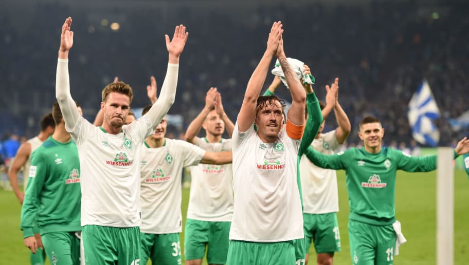 Bremen's players celebrate after the German first division Bundesliga football match Schalke 04 v Werder Bremen on October 20, 2018 in Gelsenkirchen. (Photo by Patrik STOLLARZ / AFP) / RESTRICTIONS: DFL REGULATIONS PROHIBIT ANY USE OF PHOTOGRAPHS AS IMAGE SEQUENCES AND/OR QUASI-VIDEO        (Photo credit should read PATRIK STOLLARZ/AFP/Getty Images)