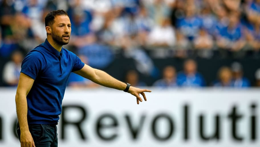 Schalke's German headcoach Domenico Tedesco reacts during the German first division Bundesliga football match FC Schalke 04 vs Eintracht Frankfurt in Gelsenkirchen, western Germany, on May 12, 2018. (Photo by SASCHA SCHUERMANN / AFP) / RESTRICTIONS: DURING MATCH TIME: DFL RULES TO LIMIT THE ONLINE USAGE TO 15 PICTURES PER MATCH AND FORBID IMAGE SEQUENCES TO SIMULATE VIDEO. == RESTRICTED TO EDITORIAL USE == FOR FURTHER QUERIES PLEASE CONTACT DFL DIRECTLY AT + 49 69 650050        (Photo credit should read SASCHA SCHUERMANN/AFP/Getty Images)