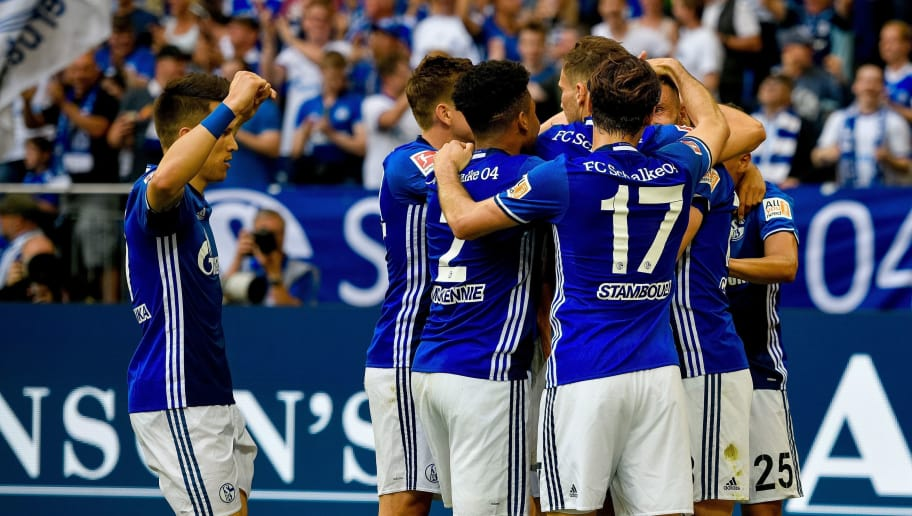Schalke's players celebrate after scoring the 1-0during the German first division Bundesliga football match FC Schalke 04 vs Eintracht Frankfurt in Gelsenkirchen, western Germany, on May 12, 2018. (Photo by SASCHA SCHUERMANN / AFP) / RESTRICTIONS: DURING MATCH TIME: DFL RULES TO LIMIT THE ONLINE USAGE TO 15 PICTURES PER MATCH AND FORBID IMAGE SEQUENCES TO SIMULATE VIDEO. == RESTRICTED TO EDITORIAL USE == FOR FURTHER QUERIES PLEASE CONTACT DFL DIRECTLY AT + 49 69 650050        (Photo credit should read SASCHA SCHUERMANN/AFP/Getty Images)