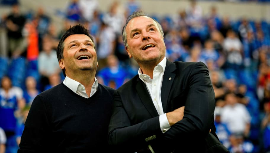 Schalke's chairman of the board Clemens Toennies (R) and manager Christian Heidel (L) are pictured after the German first division Bundesliga football match FC Schalke 04 vs Eintracht Frankfurt in Gelsenkirchen, western Germany, on May 12, 2018. (Photo by SASCHA SCHUERMANN / AFP) / RESTRICTIONS: DURING MATCH TIME: DFL RULES TO LIMIT THE ONLINE USAGE TO 15 PICTURES PER MATCH AND FORBID IMAGE SEQUENCES TO SIMULATE VIDEO. == RESTRICTED TO EDITORIAL USE == FOR FURTHER QUERIES PLEASE CONTACT DFL DIRECTLY AT + 49 69 650050        (Photo credit should read SASCHA SCHUERMANN/AFP/Getty Images)