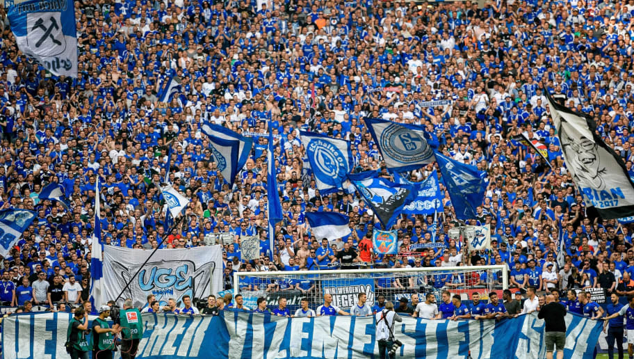 Schalke's supporters cheer up their team during the German first division Bundesliga football match FC Schalke 04 vs Eintracht Frankfurt in Gelsenkirchen, western Germany, on May 12, 2018. (Photo by SASCHA SCHUERMANN / AFP) / RESTRICTIONS: DURING MATCH TIME: DFL RULES TO LIMIT THE ONLINE USAGE TO 15 PICTURES PER MATCH AND FORBID IMAGE SEQUENCES TO SIMULATE VIDEO. == RESTRICTED TO EDITORIAL USE == FOR FURTHER QUERIES PLEASE CONTACT DFL DIRECTLY AT + 49 69 650050        (Photo credit should read SASCHA SCHUERMANN/AFP/Getty Images)