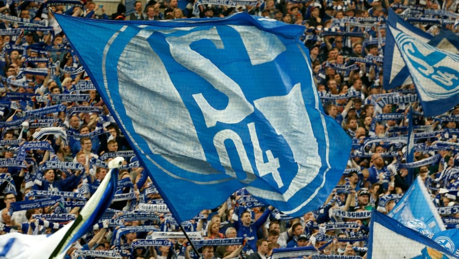 Schalke fans cheer up their team before the German first division Bundesliga football match Schalke 04 vs Borussia Moenchengladbach in Gelsenkirchen, western Germany on April 28, 2018. (Photo by LEON KUEGELER / AFP) / RESTRICTIONS: DURING MATCH TIME: DFL RULES TO LIMIT THE ONLINE USAGE TO 15 PICTURES PER MATCH AND FORBID IMAGE SEQUENCES TO SIMULATE VIDEO. == RESTRICTED TO EDITORIAL USE == FOR FURTHER QUERIES PLEASE CONTACT DFL DIRECTLY AT + 49 69 650050        (Photo credit should read LEON KUEGELER/AFP/Getty Images)