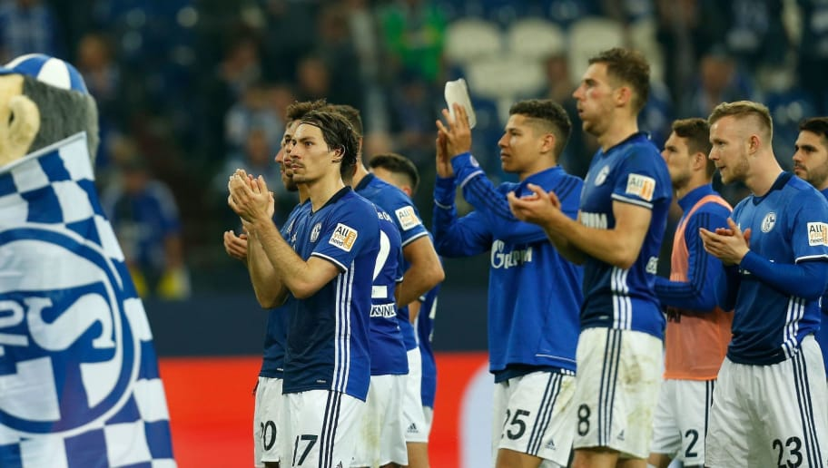 Schalke's French defender Bejamin Stambouli (L) and teammates applaud at the end of the German first division Bundesliga football match Schalke 04 vs Borussia Moenchengladbach in Gelsenkirchen, western Germany on April 28, 2018. (Photo by LEON KUEGELER / AFP) / RESTRICTIONS: DURING MATCH TIME: DFL RULES TO LIMIT THE ONLINE USAGE TO 15 PICTURES PER MATCH AND FORBID IMAGE SEQUENCES TO SIMULATE VIDEO. == RESTRICTED TO EDITORIAL USE == FOR FURTHER QUERIES PLEASE CONTACT DFL DIRECTLY AT + 49 69 650050        (Photo credit should read LEON KUEGELER/AFP/Getty Images)