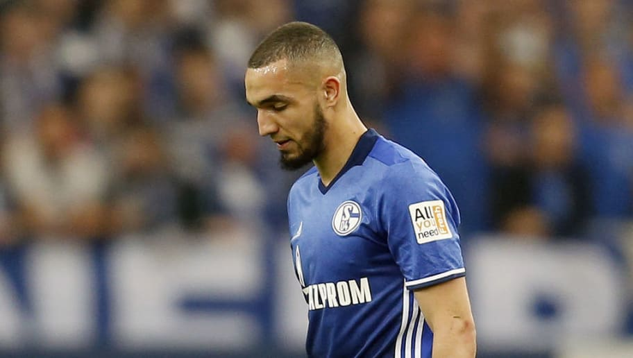 Schalke's Algerian midfielder Nabil Bentaleb leaves the pitch after he received a red card during the German first division Bundesliga football match Schalke 04 vs Borussia Moenchengladbach in Gelsenkirchen, western Germany on April 28, 2018. (Photo by LEON KUEGELER / AFP) / RESTRICTIONS: DURING MATCH TIME: DFL RULES TO LIMIT THE ONLINE USAGE TO 15 PICTURES PER MATCH AND FORBID IMAGE SEQUENCES TO SIMULATE VIDEO. == RESTRICTED TO EDITORIAL USE == FOR FURTHER QUERIES PLEASE CONTACT DFL DIRECTLY AT + 49 69 650050        (Photo credit should read LEON KUEGELER/AFP/Getty Images)