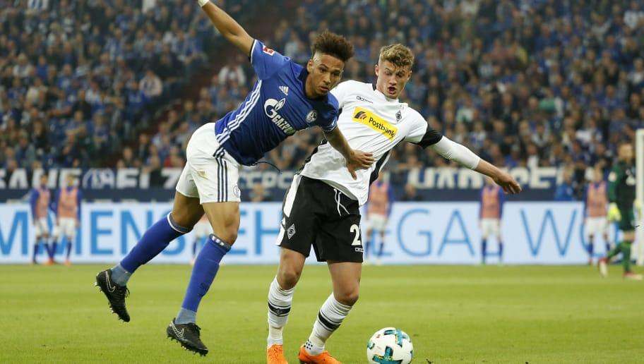 Schalke's German defender Thilo Kehrer (L) and Moenchengladbach's French midfielder Mickael Cuisance vie for the ball during the German first division Bundesliga football match Schalke 04 vs Borussia Moenchengladbach in Gelsenkirchen, western Germany on April 28, 2018. (Photo by LEON KUEGELER / AFP) / RESTRICTIONS: DURING MATCH TIME: DFL RULES TO LIMIT THE ONLINE USAGE TO 15 PICTURES PER MATCH AND FORBID IMAGE SEQUENCES TO SIMULATE VIDEO. == RESTRICTED TO EDITORIAL USE == FOR FURTHER QUERIES PLEASE CONTACT DFL DIRECTLY AT + 49 69 650050        (Photo credit should read LEON KUEGELER/AFP/Getty Images)