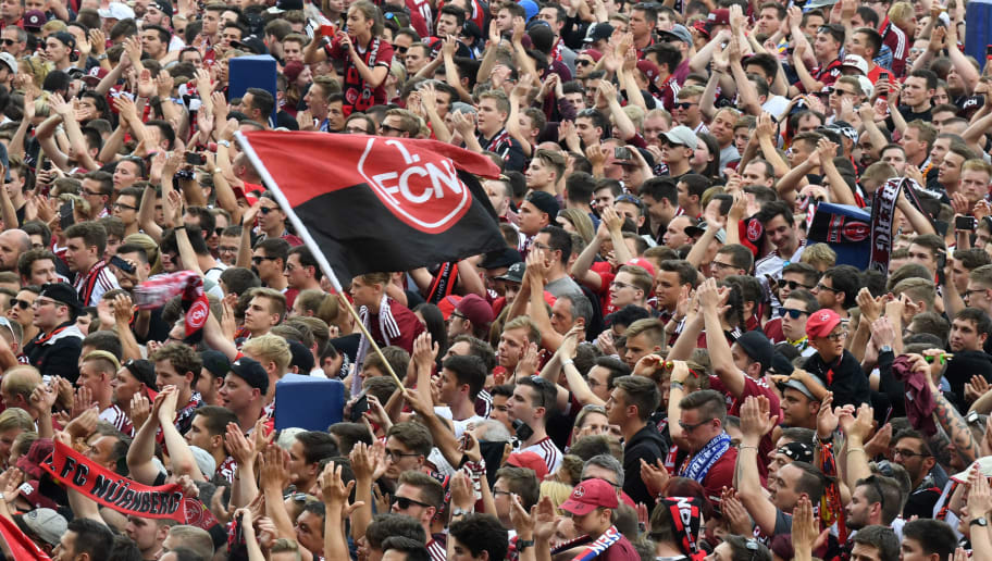Nuremberg's supporters stand at the field at the end of the German second division Bundesliga football match 1. FC Nuremberg vs Fortuna Duesseldorf in the stadium in Nuremberg, southern Germany, on May 13, 2018. - Duesseldorf won the match 3-2. (Photo by Christof STACHE / AFP) / RESTRICTIONS: DURING MATCH TIME: DFL RULES TO LIMIT THE ONLINE USAGE TO 15 PICTURES PER MATCH AND FORBID IMAGE SEQUENCES TO SIMULATE VIDEO. == RESTRICTED TO EDITORIAL USE == FOR FURTHER QUERIES PLEASE CONTACT DFL DIRECTLY AT + 49 69 650050        (Photo credit should read CHRISTOF STACHE/AFP/Getty Images)