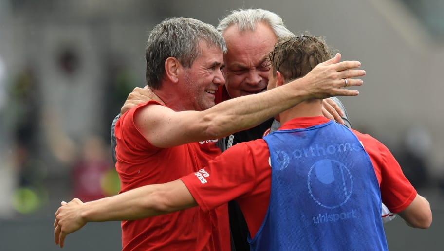 (L-R) Duesseldorf's headcoach Friedhelm Funkel, team doctor Ulf Blecker and defender Julian Schauerter celebrate at the end of the German second division Bundesliga football match 1. FC Nuremberg vs Fortuna Duesseldorf in the stadium in Nuremberg, southern Germany, on May 13, 2018. - Duesseldorf won the match 3-2. (Photo by Christof STACHE / AFP) / RESTRICTIONS: DURING MATCH TIME: DFL RULES TO LIMIT THE ONLINE USAGE TO 15 PICTURES PER MATCH AND FORBID IMAGE SEQUENCES TO SIMULATE VIDEO. == RESTRICTED TO EDITORIAL USE == FOR FURTHER QUERIES PLEASE CONTACT DFL DIRECTLY AT + 49 69 650050        (Photo credit should read CHRISTOF STACHE/AFP/Getty Images)