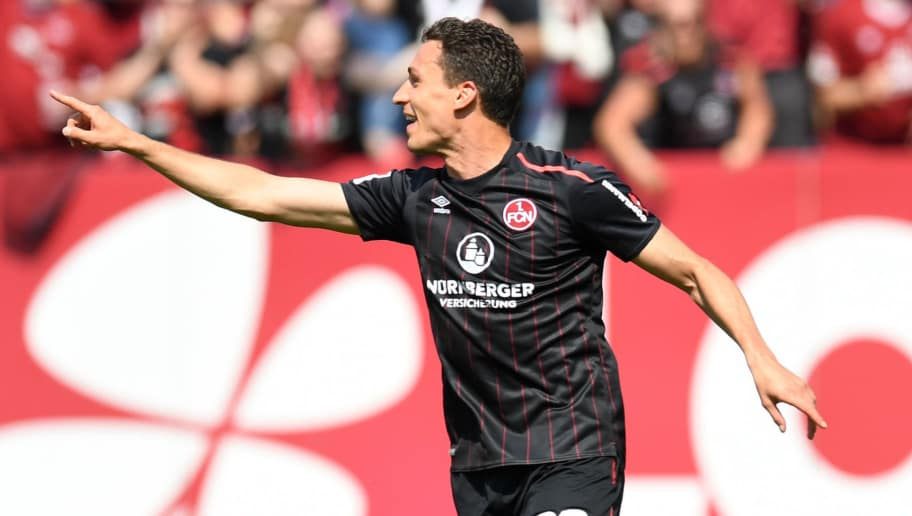 Nuremberg's midfielder Georg Margreitter celebrates after scoring the 1-0 during the German second division Bundesliga football match 1 FC Nuernberg vs Fortuna Duesseldorf in Nuremberg, southern Germany, on May 13, 2018. (Photo by Christof STACHE / AFP) / RESTRICTIONS: DURING MATCH TIME: DFL RULES TO LIMIT THE ONLINE USAGE TO 15 PICTURES PER MATCH AND FORBID IMAGE SEQUENCES TO SIMULATE VIDEO. == RESTRICTED TO EDITORIAL USE == FOR FURTHER QUERIES PLEASE CONTACT DFL DIRECTLY AT + 49 69 650050        (Photo credit should read CHRISTOF STACHE/AFP/Getty Images)