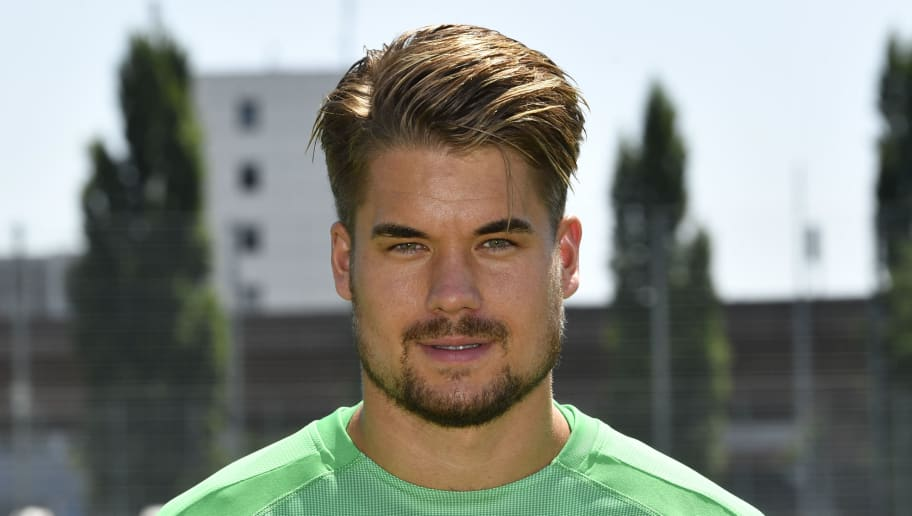 Goalkeeper Alexander Meyer of German first division Bundesliga football team VfB Stuttgart poses for a family picture during the team's official presentation for the 2018-2019 season on July 19, 2018 in Stuttgart, southern Germany. (Photo by THOMAS KIENZLE / AFP)        (Photo credit should read THOMAS KIENZLE/AFP/Getty Images)